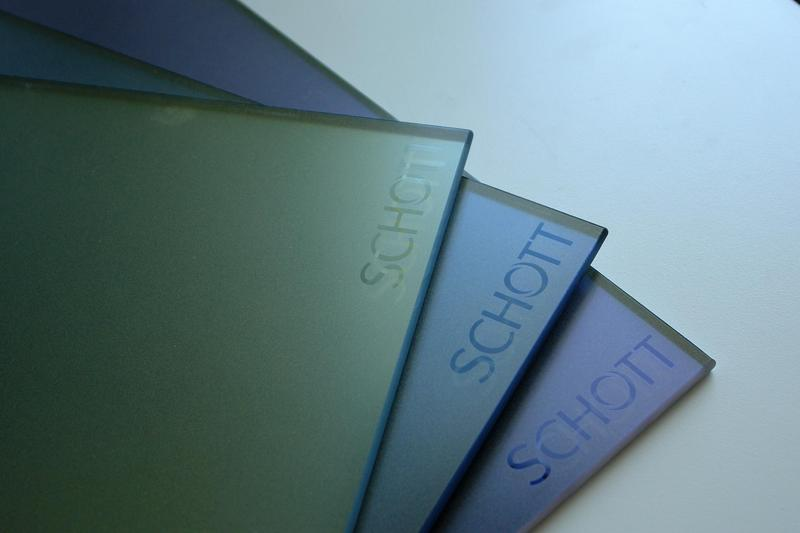 Three samples of colored glasses with SCHOTT® logo