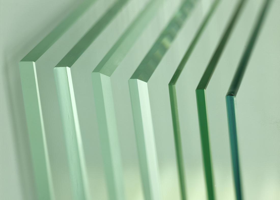 Stack of clear glass panels with different edge designs